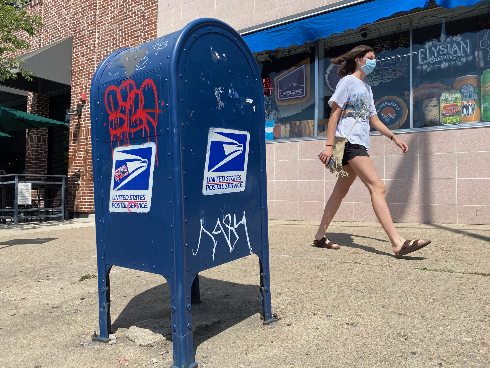 Postmaster general says he's suspending post office overhaul until after the election