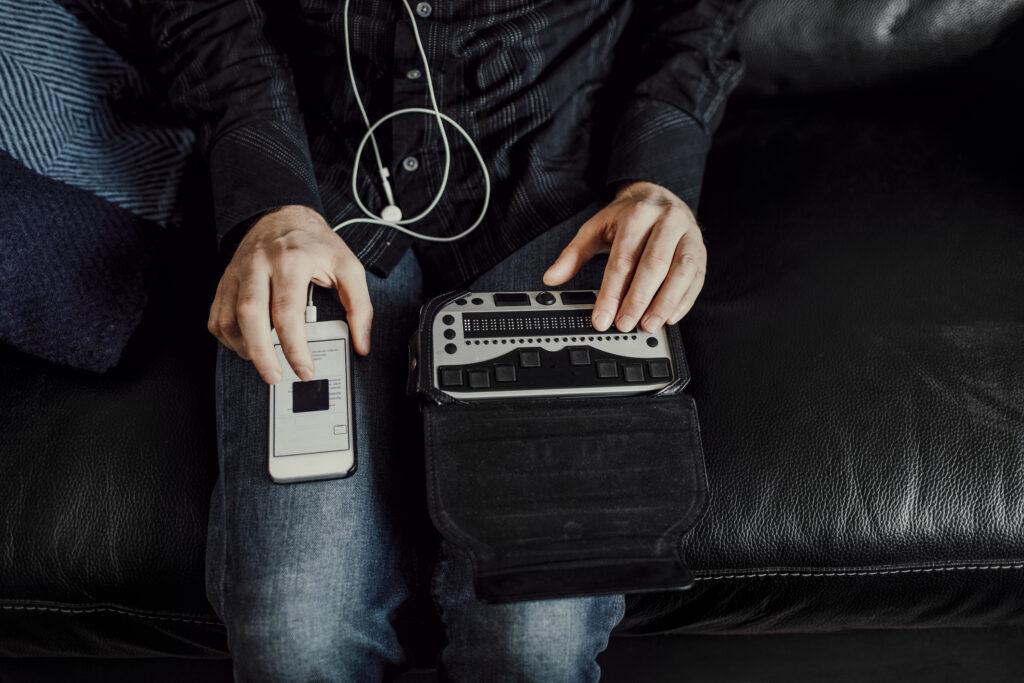 Man using Braille keyboard